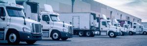 Header-semi-trucks-at-warehouse